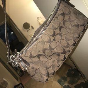 Chocolate coach clutch purse